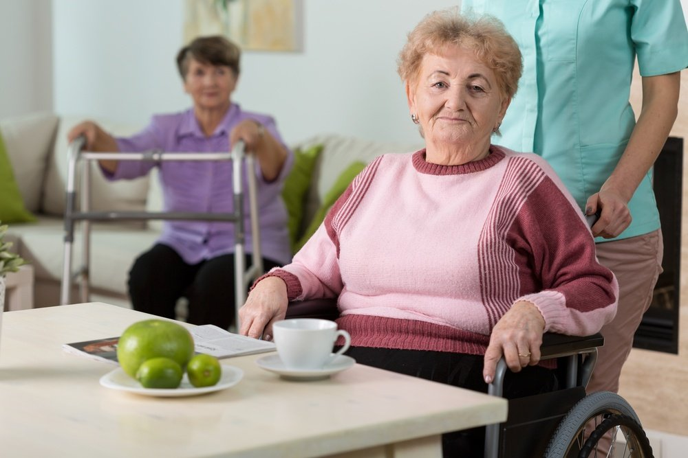 Older disabled woman on wheelchair in nursing home.jpeg